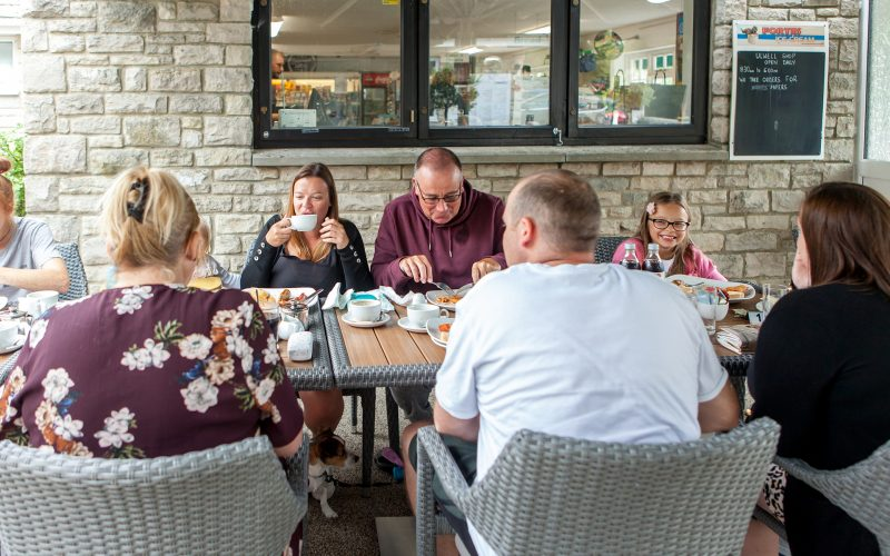 family eating in the outside dining area