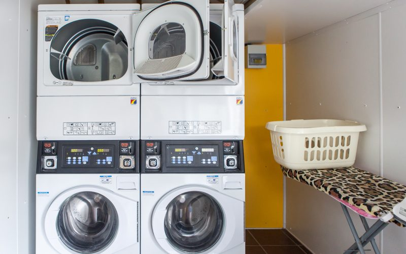 washing machines and tumble dryers in the on site laundry