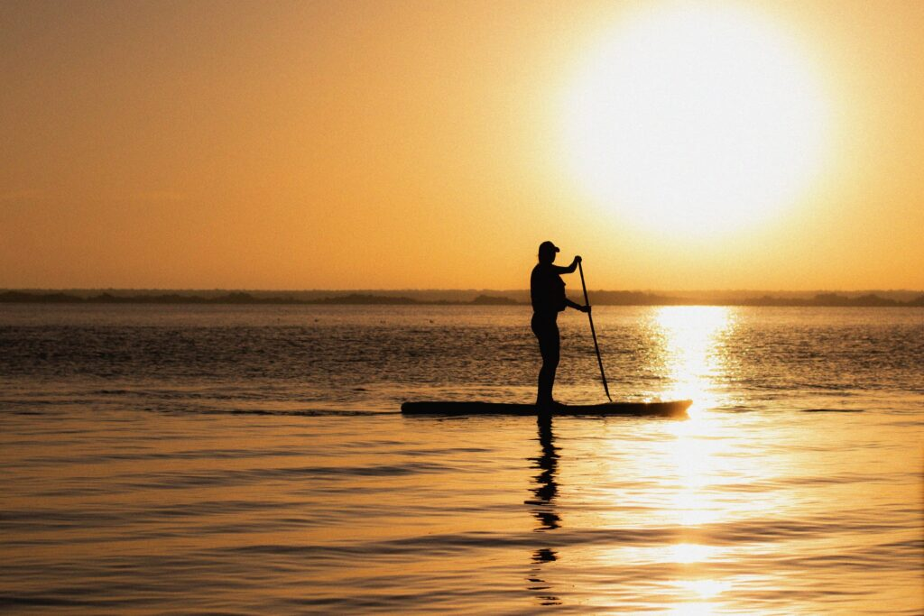 Stand up paddleboarding sunset