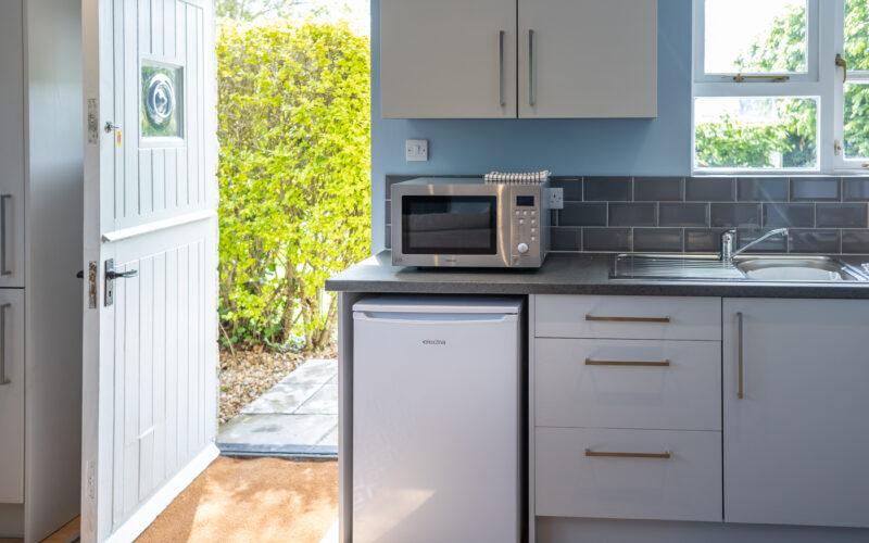 the studio kitchen leading out to garden